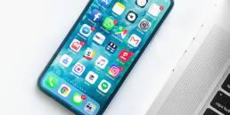 white smartphone near laptop